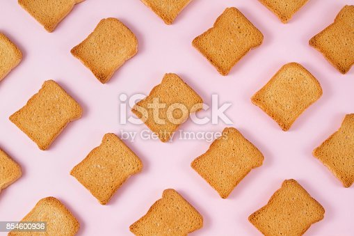 istock Slice of Toasted Bread on Pink Background 854600936