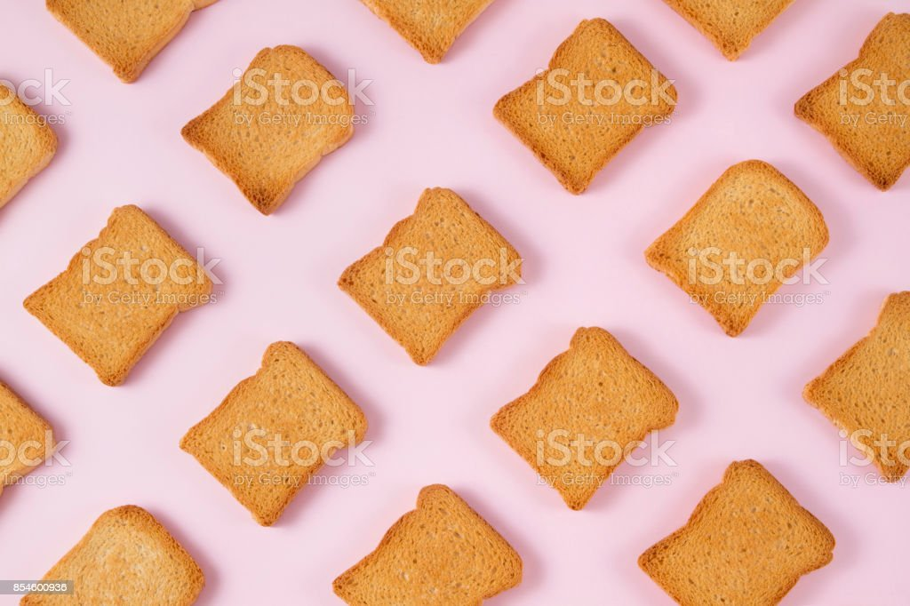 Slice of Toasted Bread on Pink Background stock photo