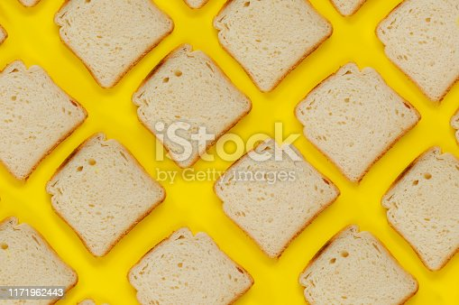 istock Slice of Toasted Bread on Yellow Background 1171962443