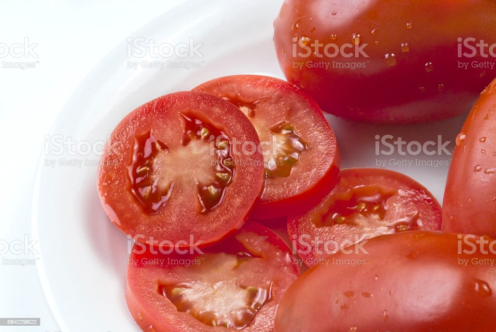 Slice of tomatos served in a white dish stock photo
