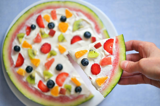 A Slice Of Watermelon Pizza Exotic Fruit Salad stock photo