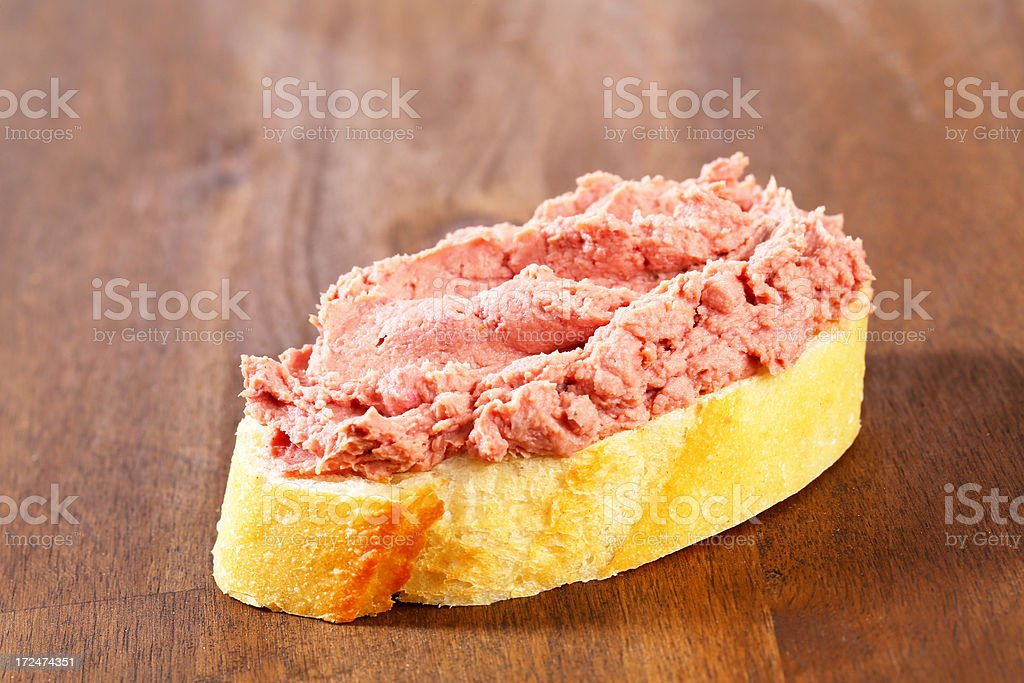 Slice of white bread with  pate and cranberry dip royalty-free stock photo