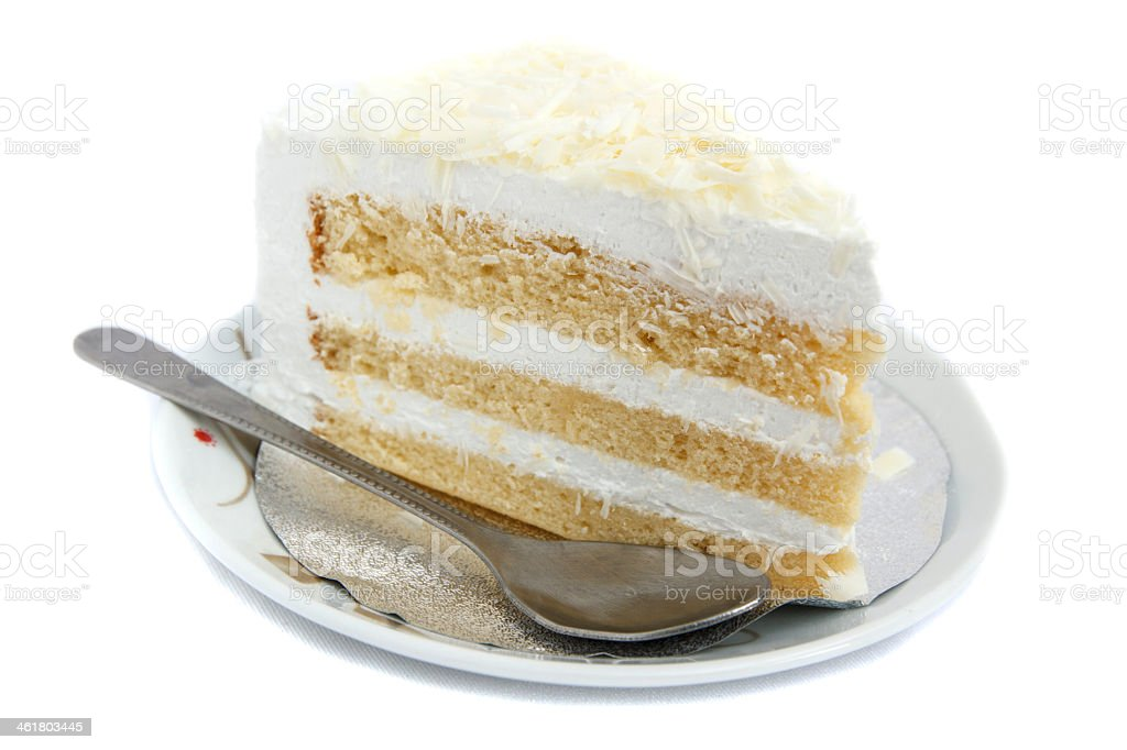 A slice of white chocolate cake stock photo