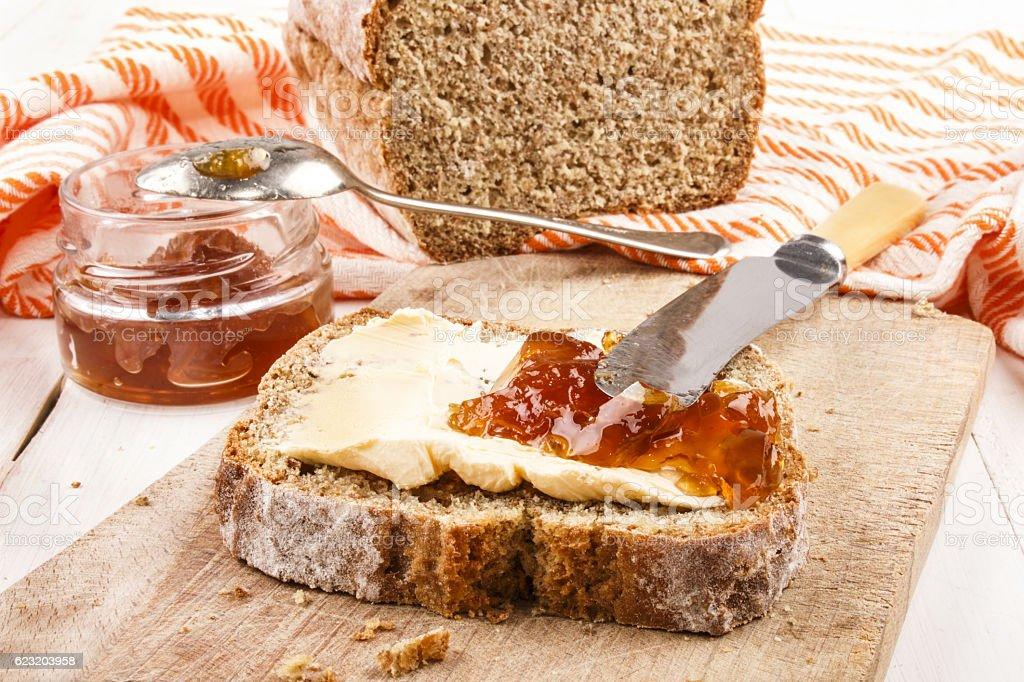 slice traditional irish soda bread with margarine stock photo