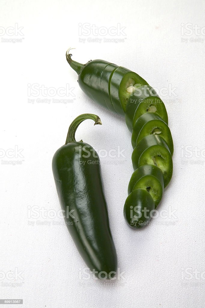 sliced and whole jalapeno royalty-free stock photo