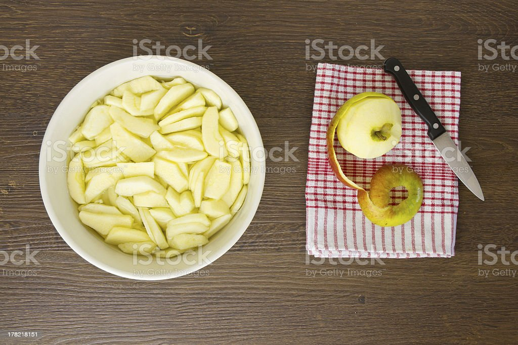 Sliced apples for pie with peeled apple royalty-free stock photo