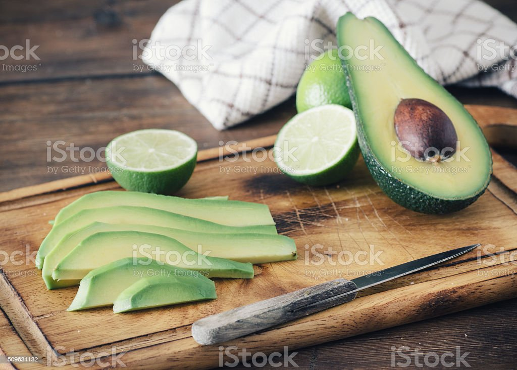 Sliced avocado and lemon stock photo
