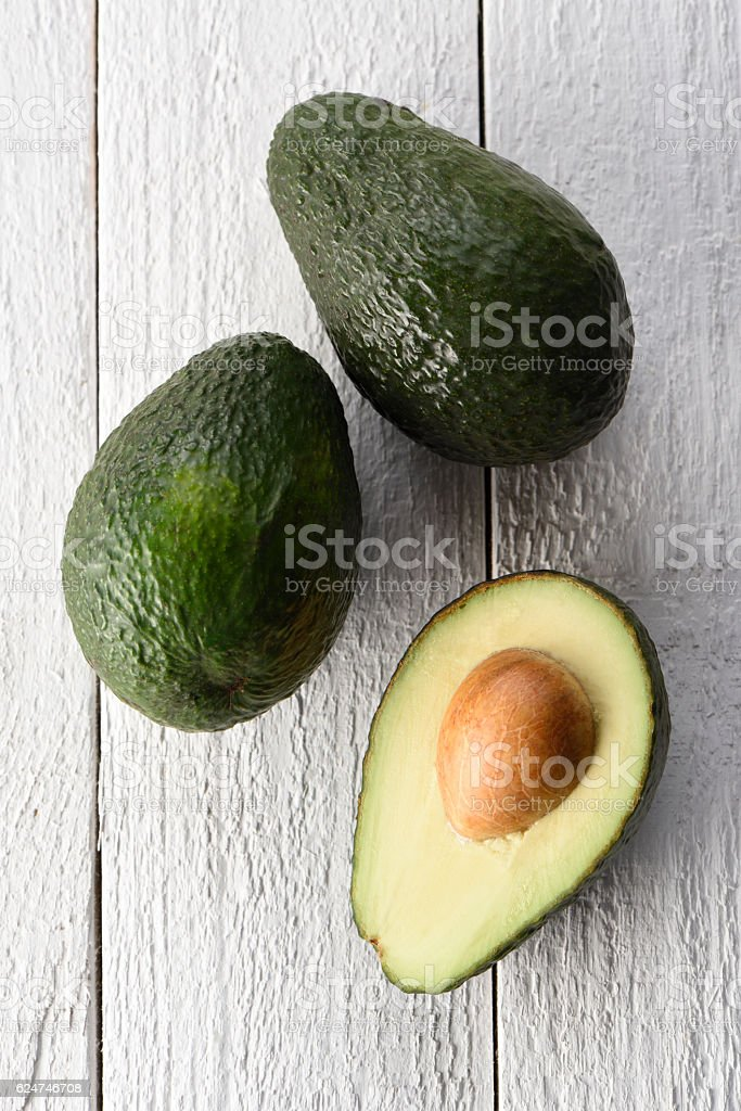 Sliced avocado on a white background stock photo