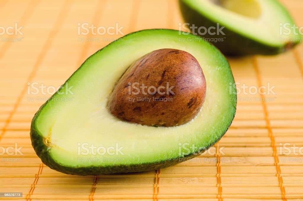 Sliced avocado on the place mat royalty-free stock photo