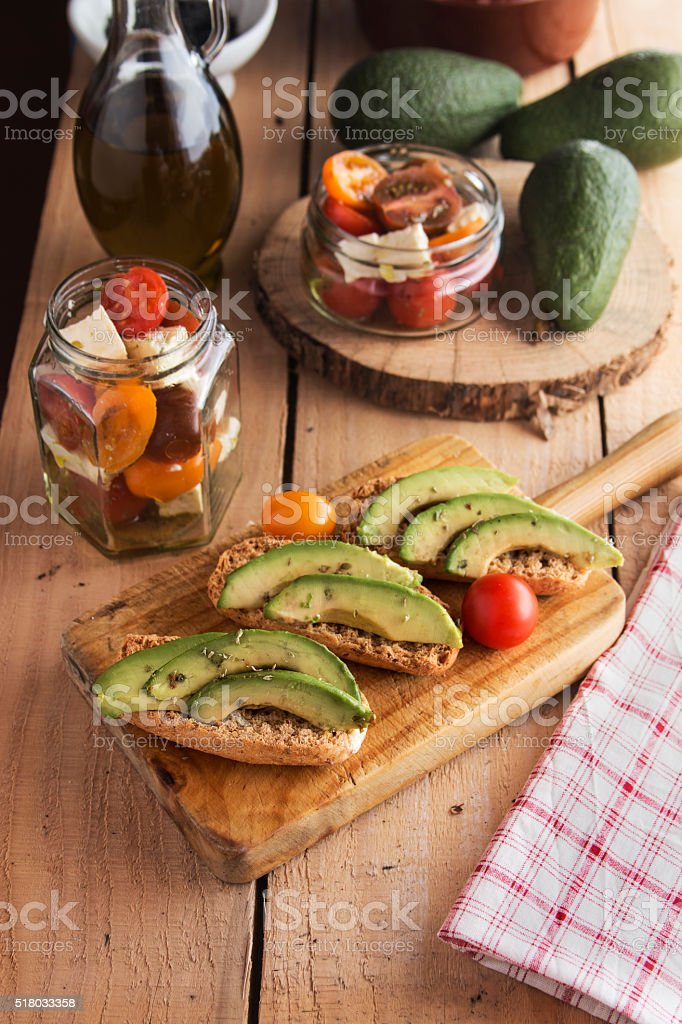 Sliced avocado on toast bread with spices stock photo