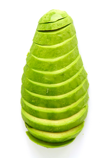 Sliced avocado isolated on original background with clipping path.