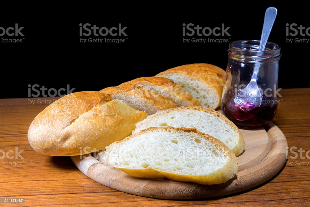Sliced baguette ready serve with blueberry jam stock photo