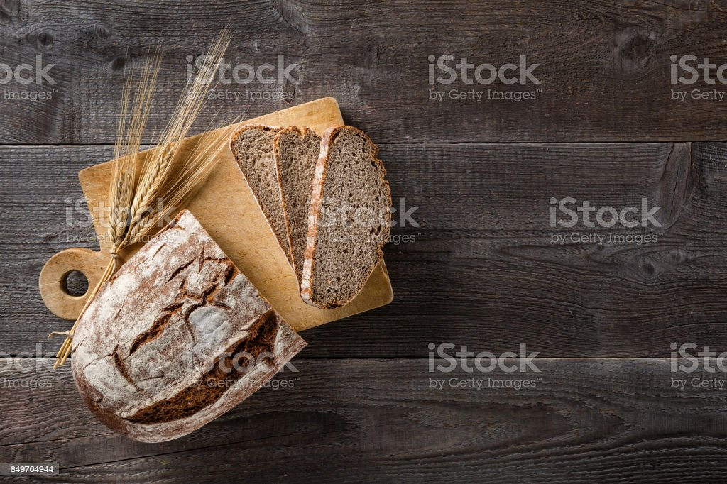 Sliced baked bread on cutting board stock photo