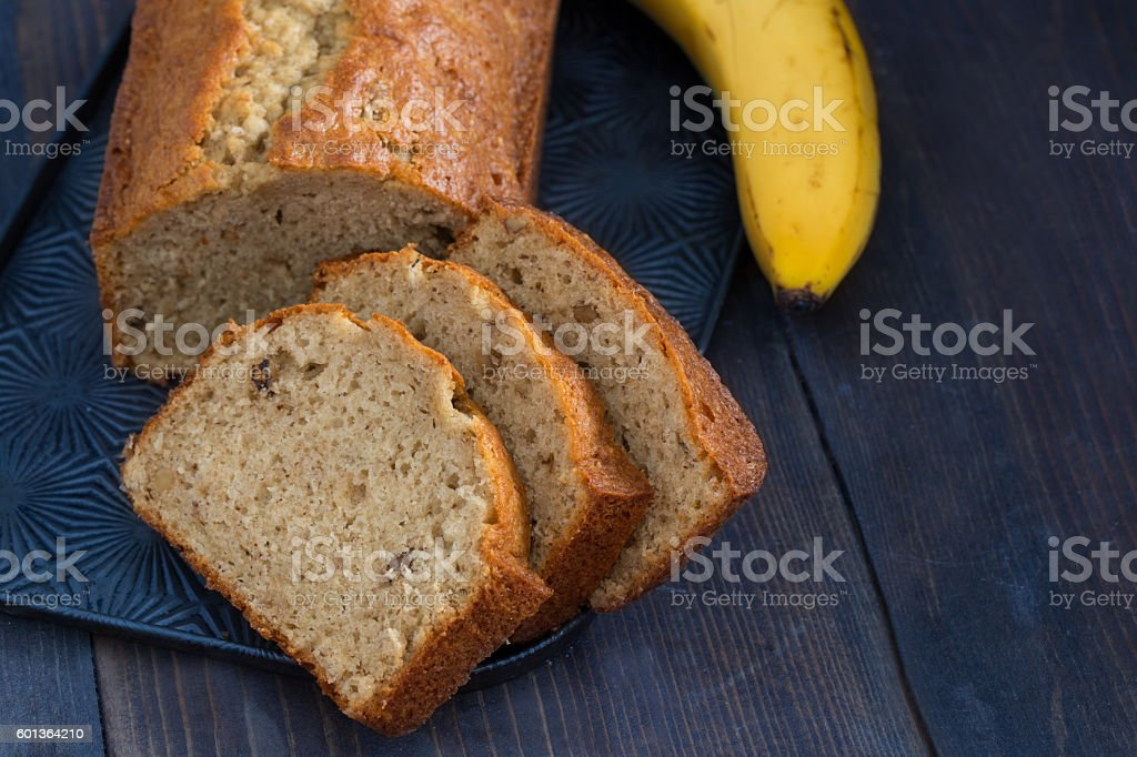 Sliced Banana Bread And A Banana stock photo