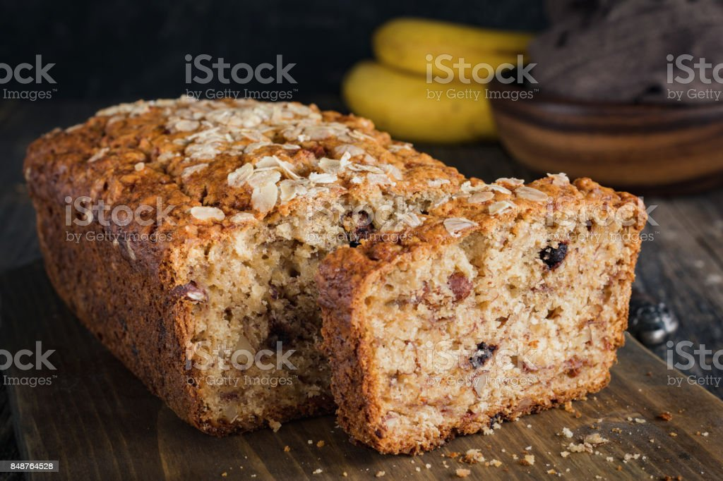 Sliced banana bread loaf with walnuts and oats stock photo