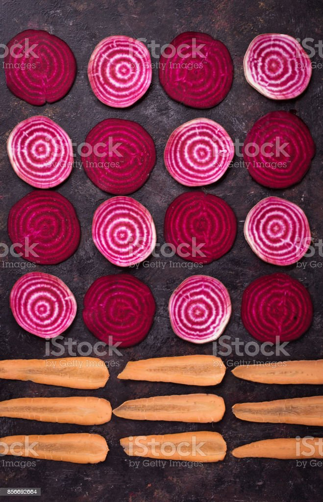 Sliced beetroot and carrots стоковое фото