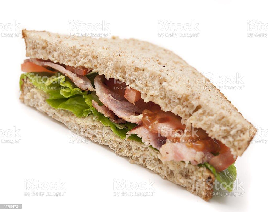sliced BLT sandwich against white royalty-free stock photo