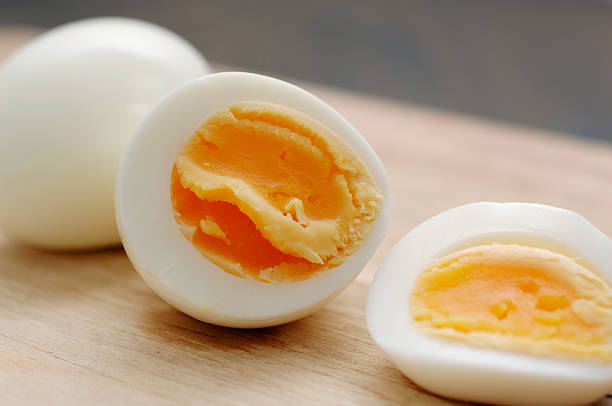 sliced boiled and peeled hens egg stock photo