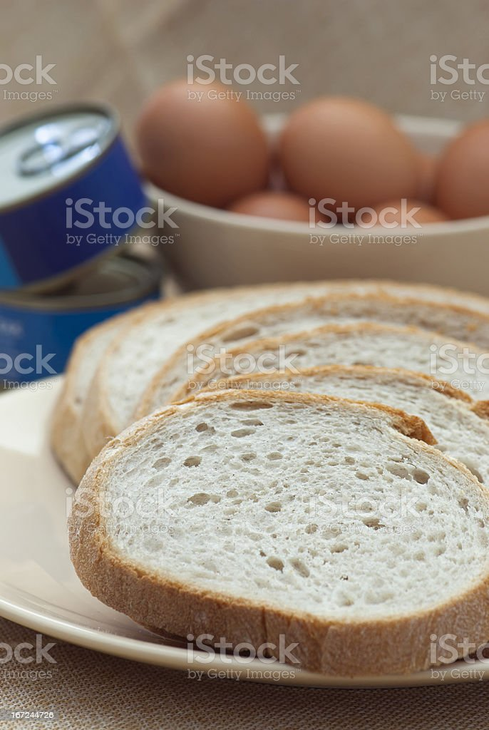 Sliced bread, canned food and eggs in a bowl. royalty-free stock photo