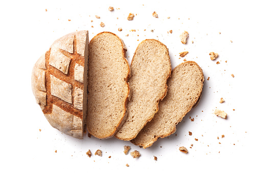 Sliced bread isolated on a white background. Bread slices and crumbs viewed from above. Top view