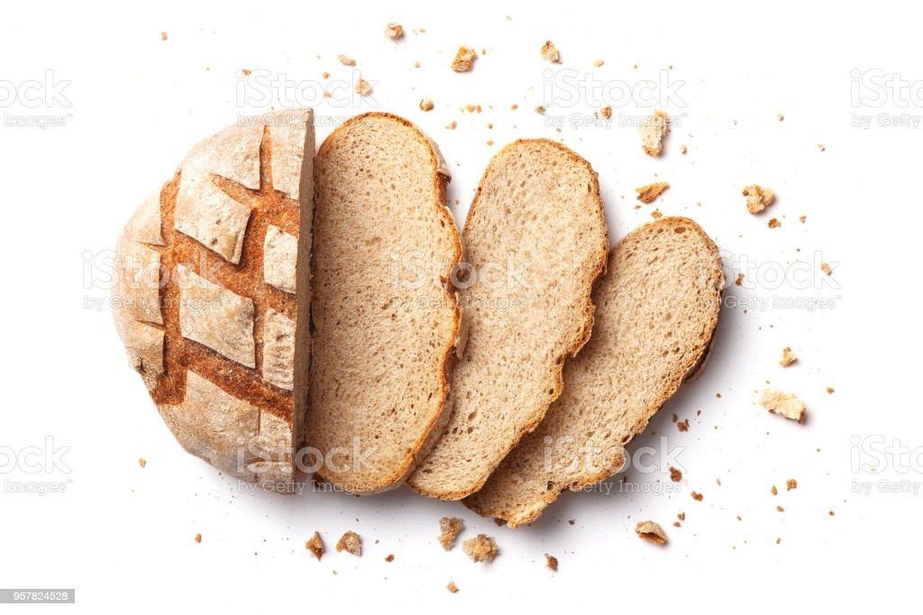Sliced bread isolated on a white background. Bread slices and crumbs viewed from above. Top view stock photo