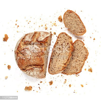 istock Sliced bread isolated on  white background. Fresh Bread slices close up. Bakery, food concept. Top view 1127296444