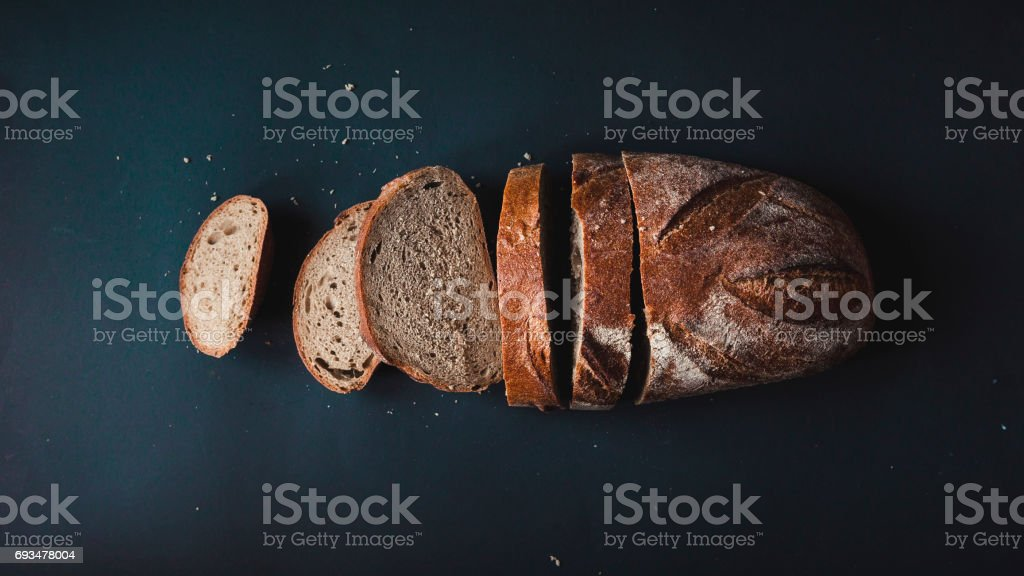 Sliced bread on a blue background. stock photo