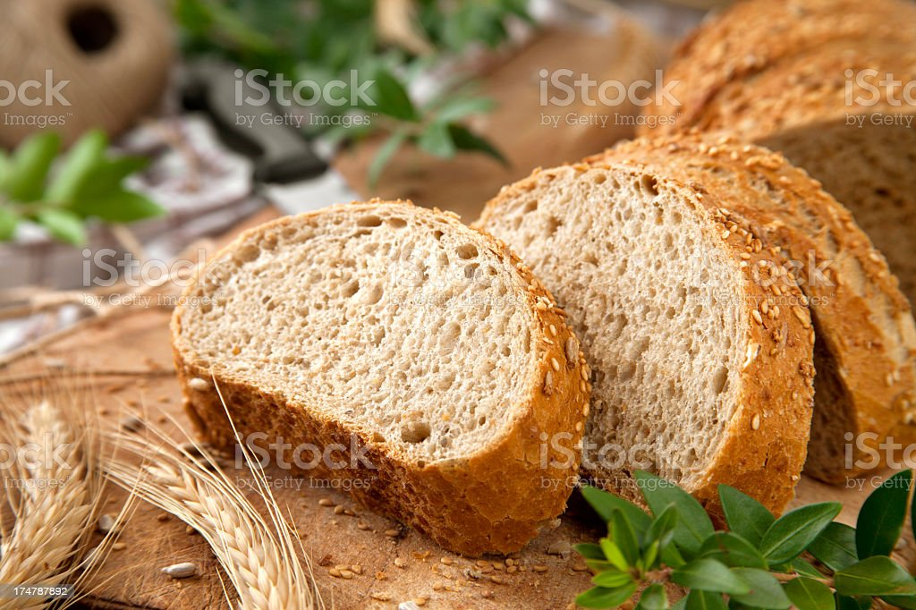 Sliced bread on a chopping board stock photo