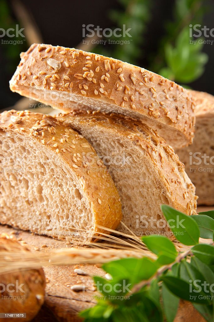 Sliced bread on a chopping board royalty-free stock photo