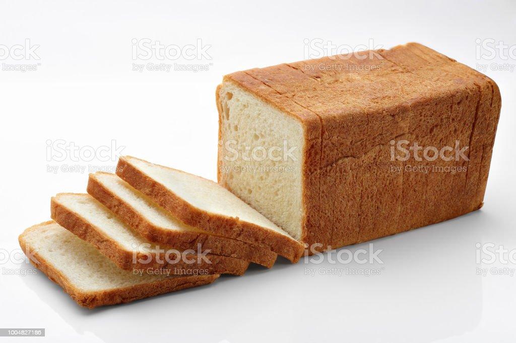 sliced bread on white stock photo