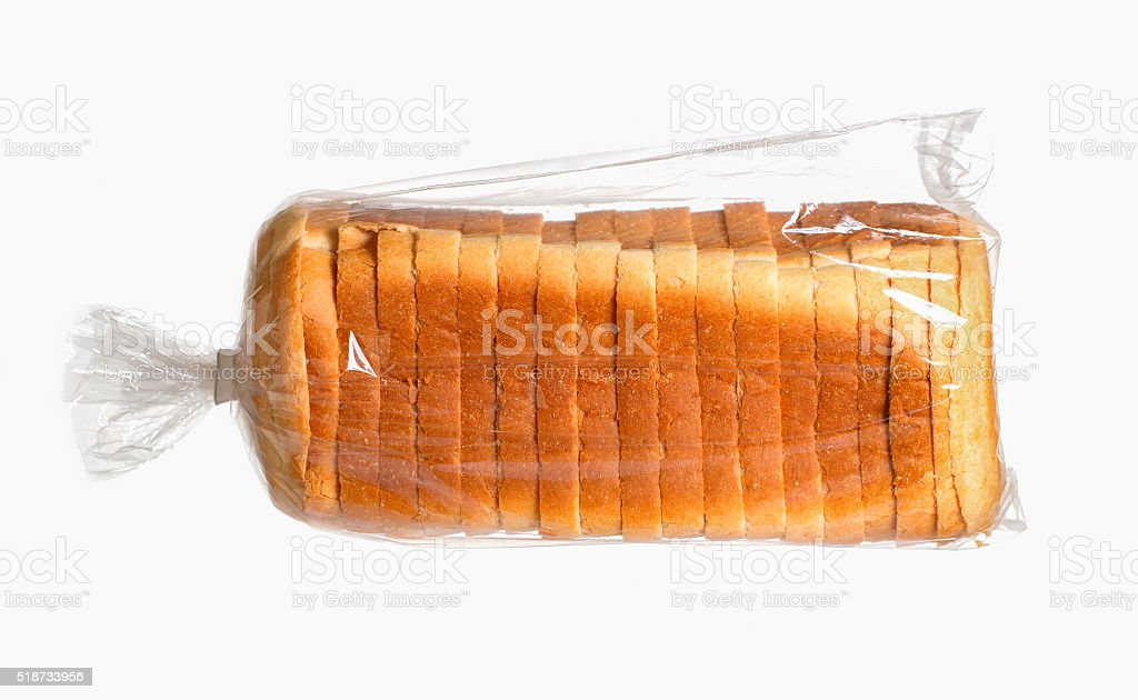 Sliced bread on white surface. stock photo