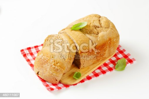 sliced fresh white bread on wooden cutting board and chequered dishtowel