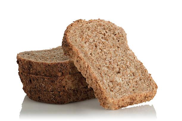 sliced bread, wholemeal, with seeds - pan multicereales fotografías e imágenes de stock