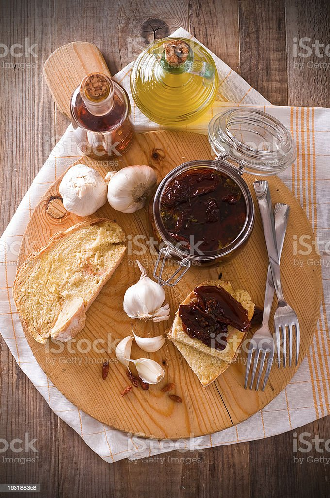 Sliced bread with dried tomato under oil. stock photo