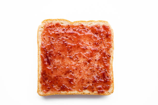 Sliced bread with jam  isolated on white background stock photo