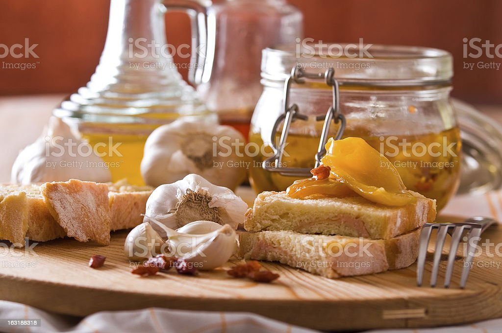 Sliced bread with peppers under oil. royalty-free stock photo