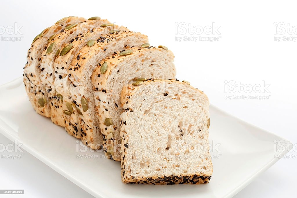 Sliced bread with pumpkin seeds and sesame stock photo