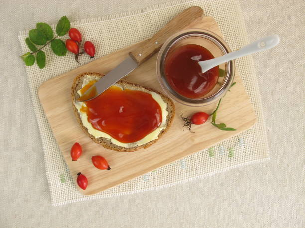 Sliced bread with rose hip jam for breakfast stock photo