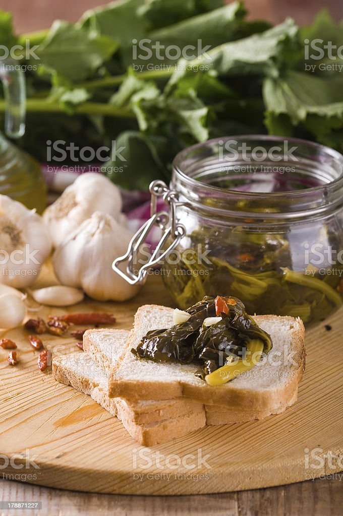 Sliced bread with turnip tops under oil. royalty-free stock photo