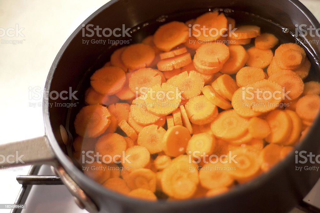 Sliced Carrots Cooking on the stove royalty-free stock photo