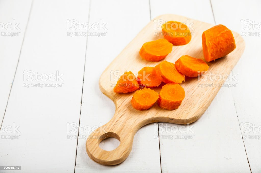 Sliced carrots on a cutting board stock photo