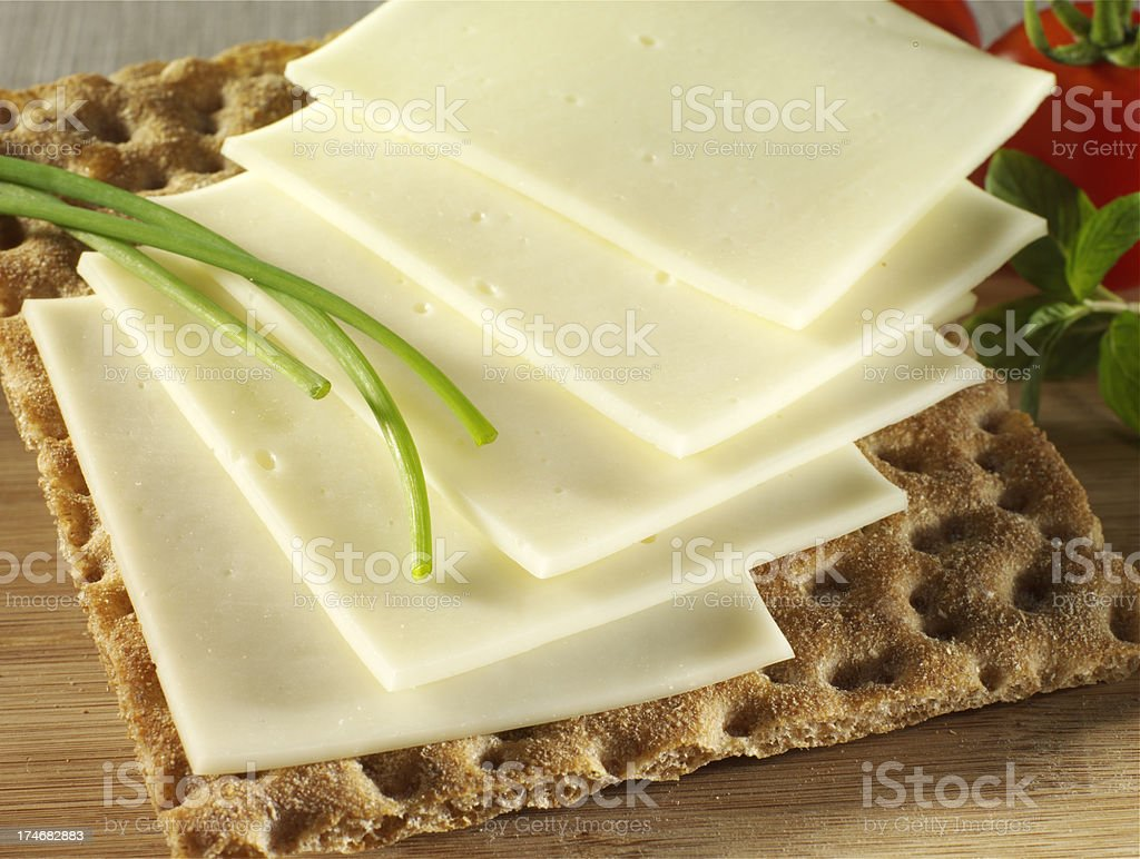 sliced cheese on cracker royalty-free stock photo