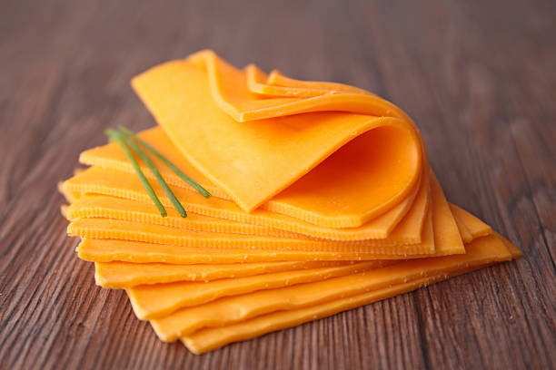 sliced cheese sliced cheese cheddar cheese stock pictures, royalty-free photos & images