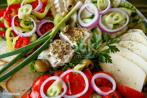Assortment of cheese with sliced vegetables and spice
