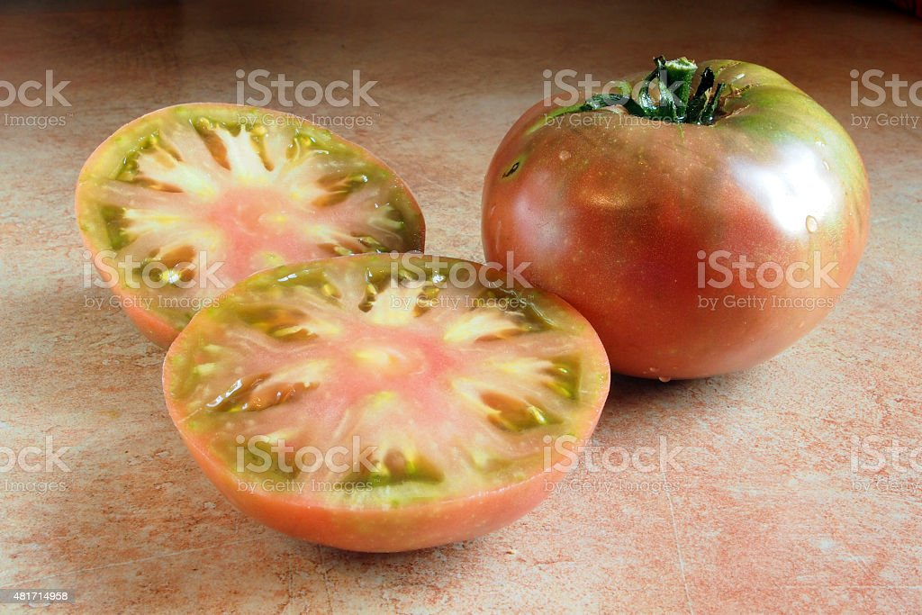 sliced cherokee purple tomato stock photo