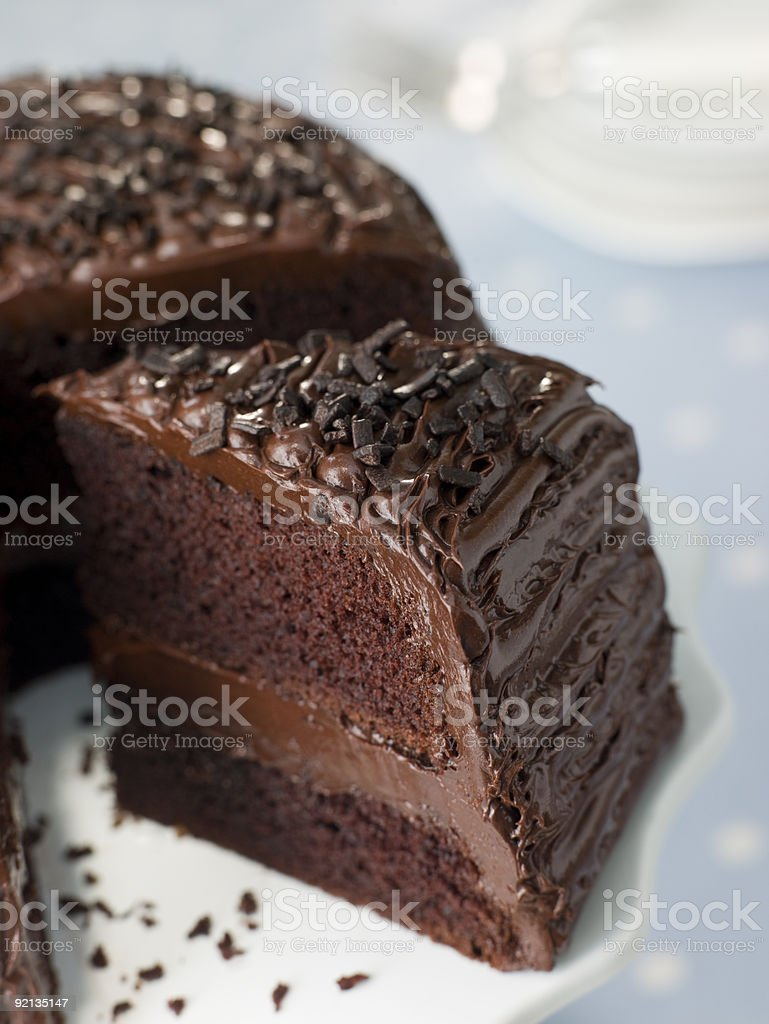 Sliced chocolate fudge cake on a plate stock photo