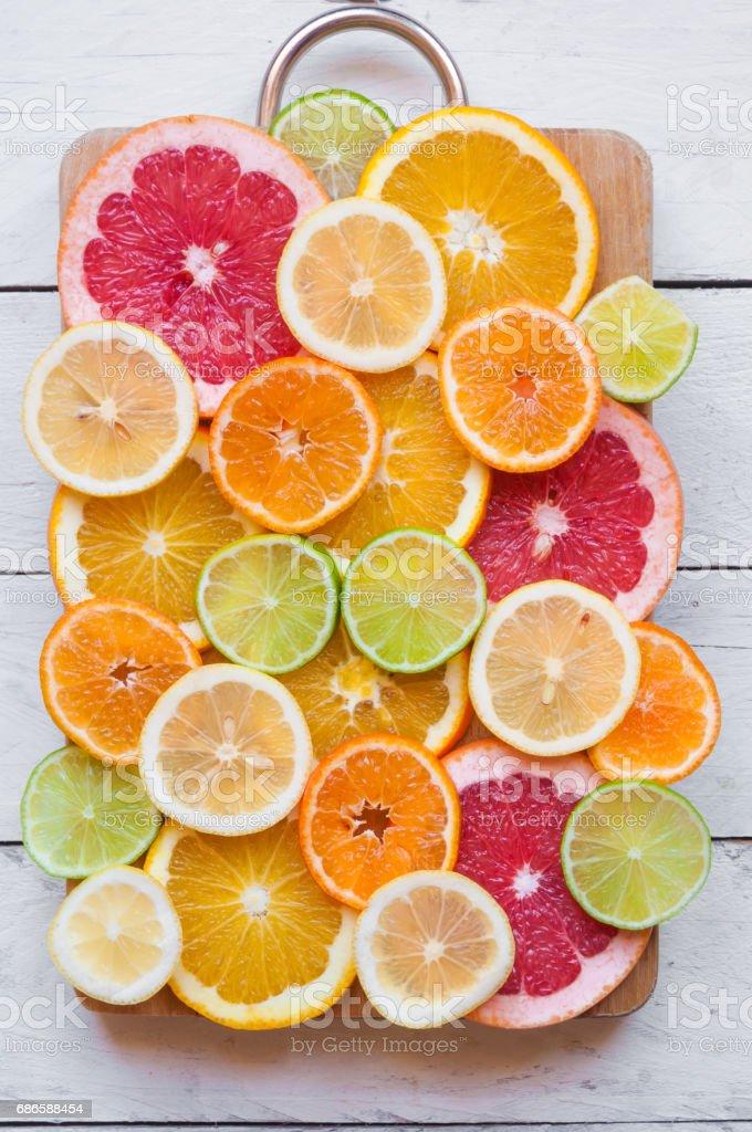 Sliced citrus fruits (grapefruit, oranges, lime, lemon) royalty-free stock photo