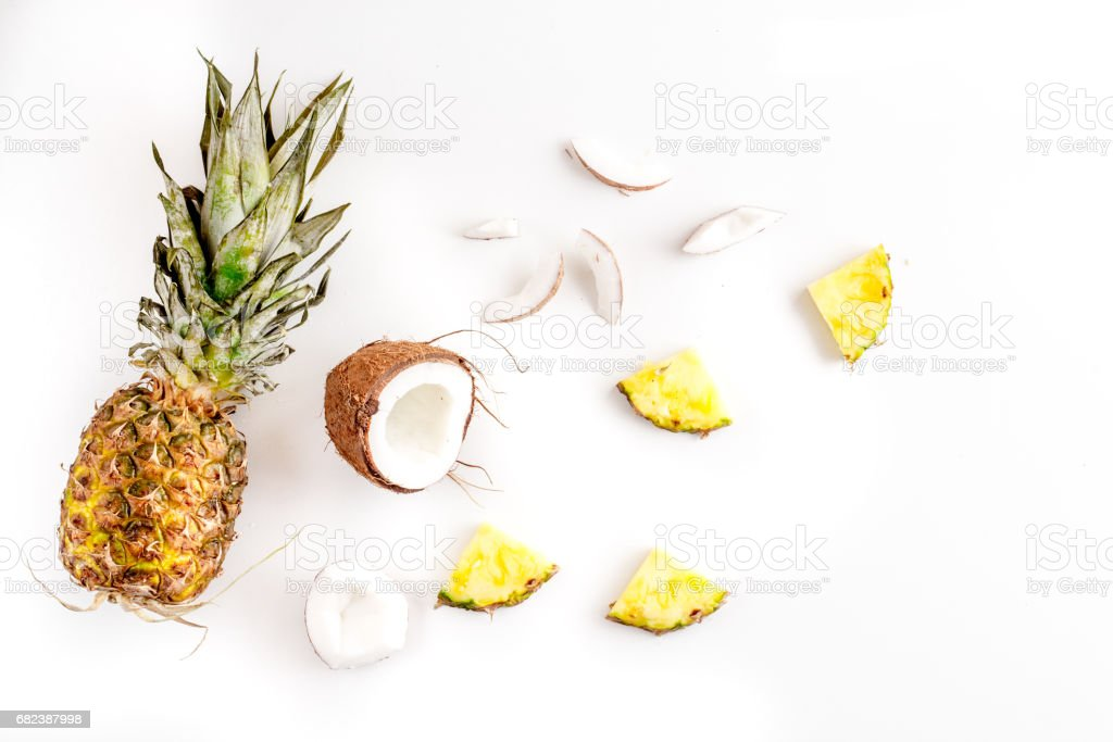 sliced coconut and pineapple in exotic summer fruit design white background top view mock-up foto stock royalty-free
