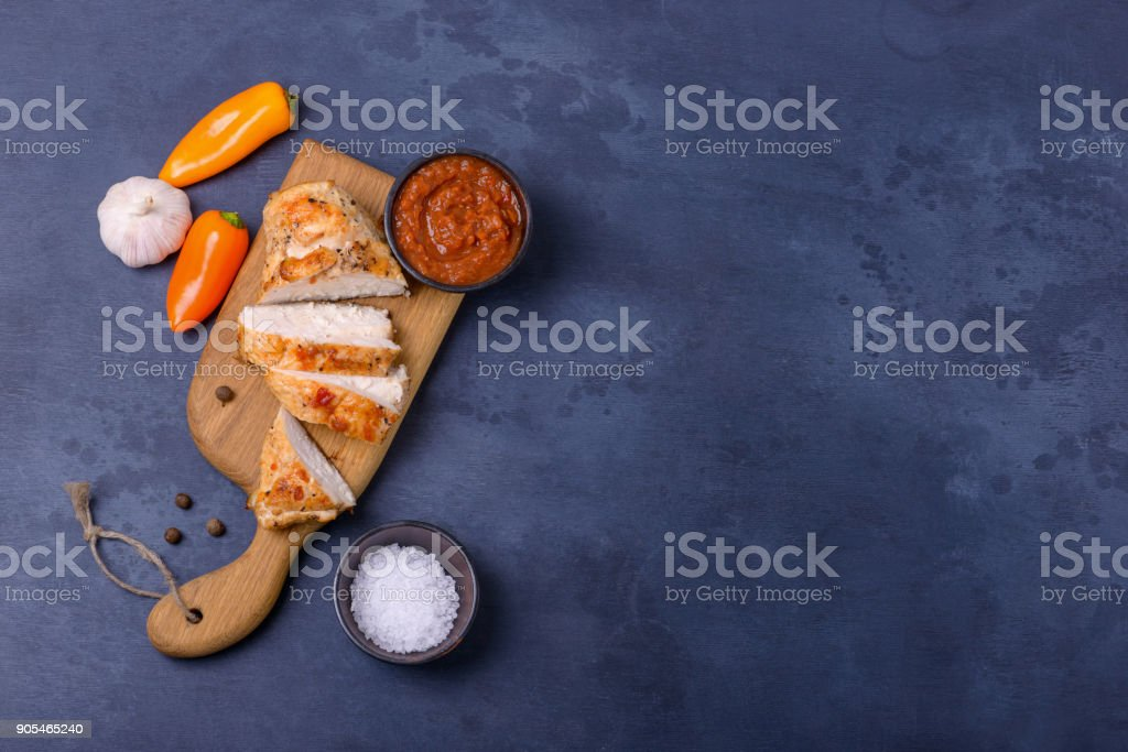 Sliced cooked chicken with sauce stock photo