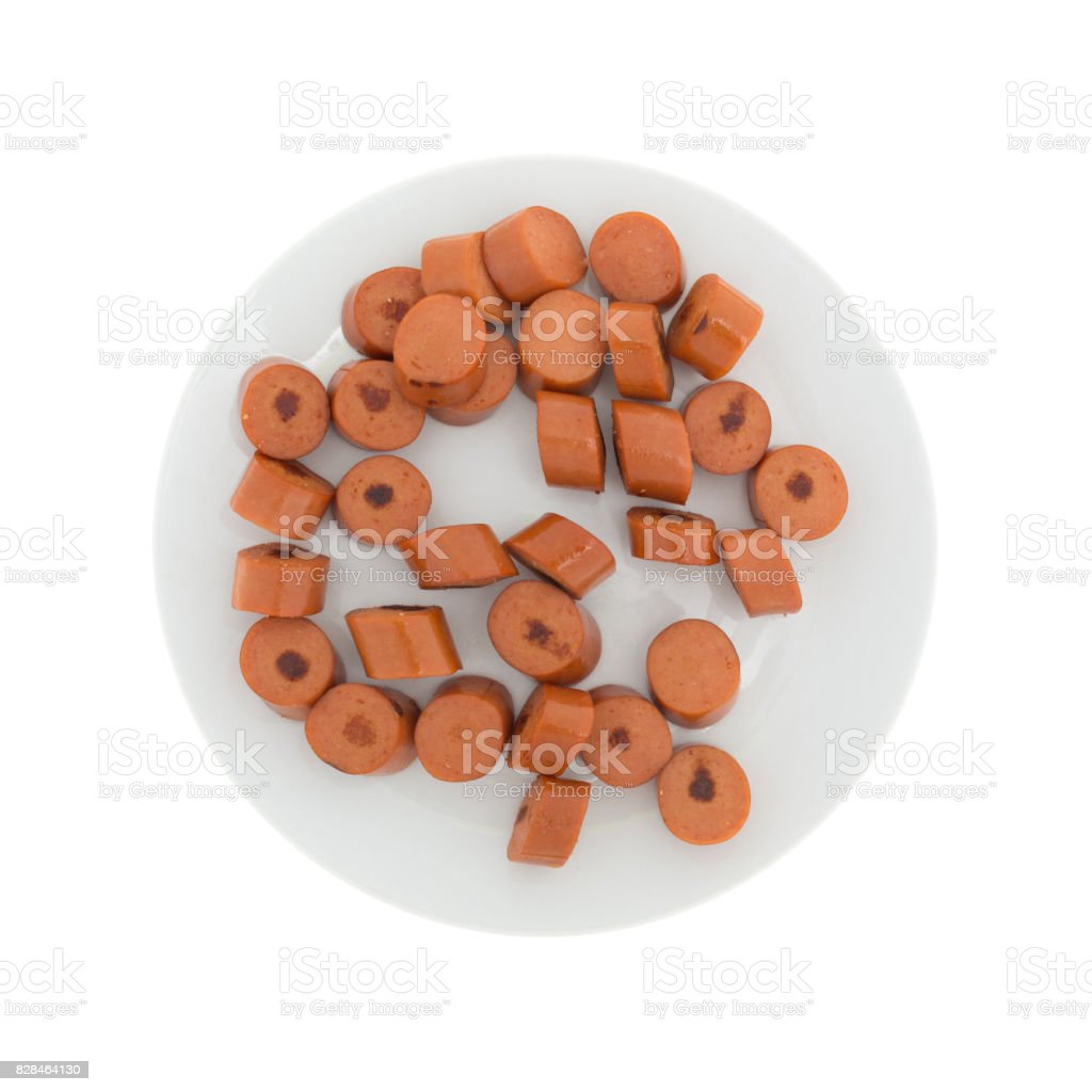 Sliced cooked hot dogs on a white plate stock photo